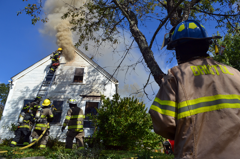 Firefighters work at 7 Redonnett Mill Road in Bristol Mills the morning of Tuesday, Oct. 3. (Maia Zewert photo)