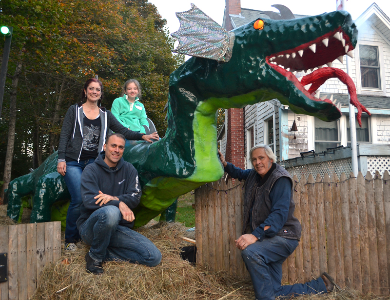 From left: April Morrison, Leon Vanella, Sophie Yates-Paul, and Michael Morrison pose next to Colby the dragon at the Haunted Castle's Keep in New Harbor on Sunday, Oct. 22. (Maia Zewert photo)