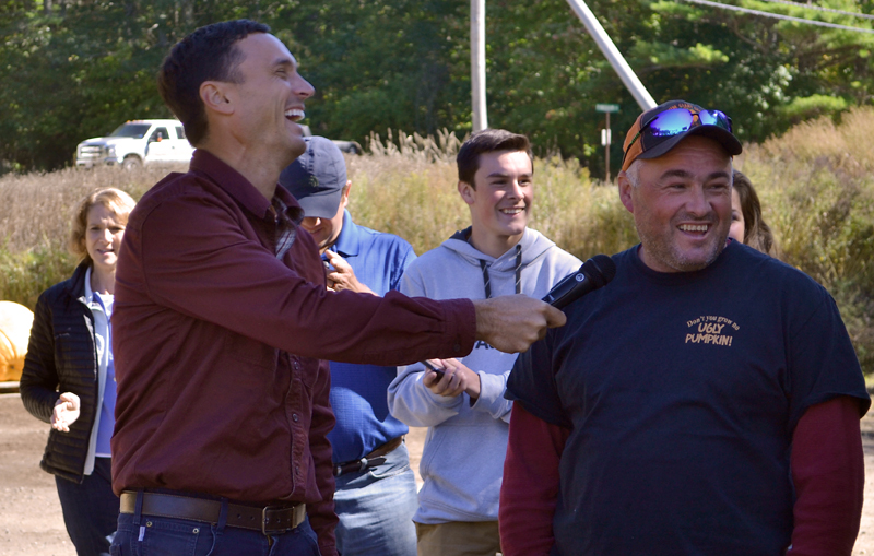 Charlie Lopresti (left) laughs as Scott St. Laurent reacts to the weighing of his pumpkin Sunday, Oct. 1. St. Laurent grew a 1,330-pound fruit, his first fruit over 1,000 pounds. (Maia Zewert photo)