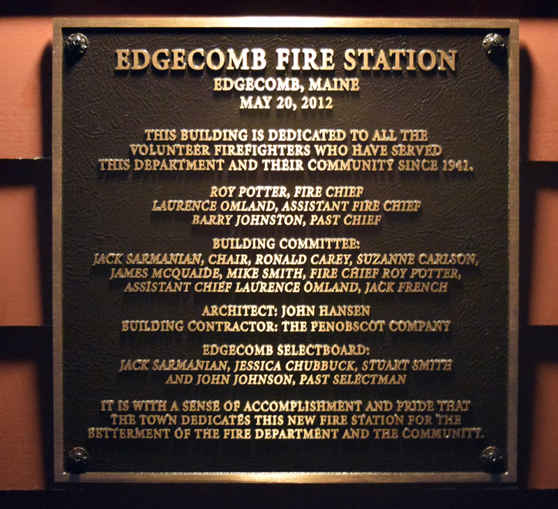 A new plaque at the Edgecomb fire station recognizes the many contributors to the building's construction. (J.W. Oliver photo)