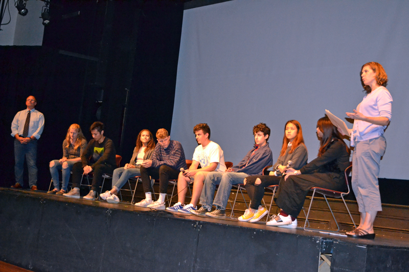 "Lincoln Academy Director of Resident Life Ken Stevenson (left) and Kelley Duffy, a Lincoln Academy social studies teacher, flank the eight LA students participating in a Q&A session after the screening of ""Maineland"" on Oct. 4 at Lincoln Theater. (Christine LaPado-Breglia photo)"