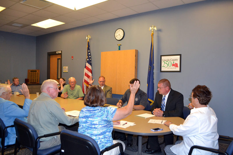 The Lincoln and Sagadahoc Multicounty Jail Authority Board of Directors votes to appoint James Bailey (second from right) administrator of Two Bridges Regional Jail during a special meeting Wednesday, Sept. 27. (Charlotte Boynton photo)