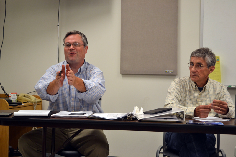 Aaron Miller (left), administrative assistant to the Whitefield Board of Selectmen, discusses possible new ways to alert the public to horse-and-buggy traffic in the area as Selectman Tony Marple looks on. (Christine LaPado-Breglia photo)