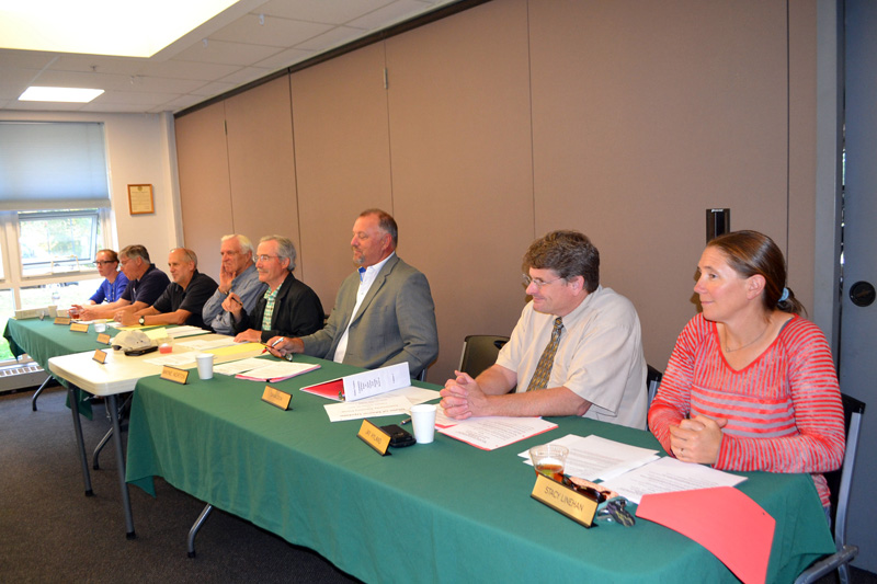 The Maine Yankee Community Advisory Panel on Spent Nuclear Fuel Storage and Removal meets at the Wiscasset Community Center on Oct. 10. From left: Misty Parker, Chris Johnson, Ralph Keyes, Dan Thompson, Chair Don Hudson, Wayne Norton, Jay Hyland, and Stacy Linehan. (Charlotte Boynton photo)