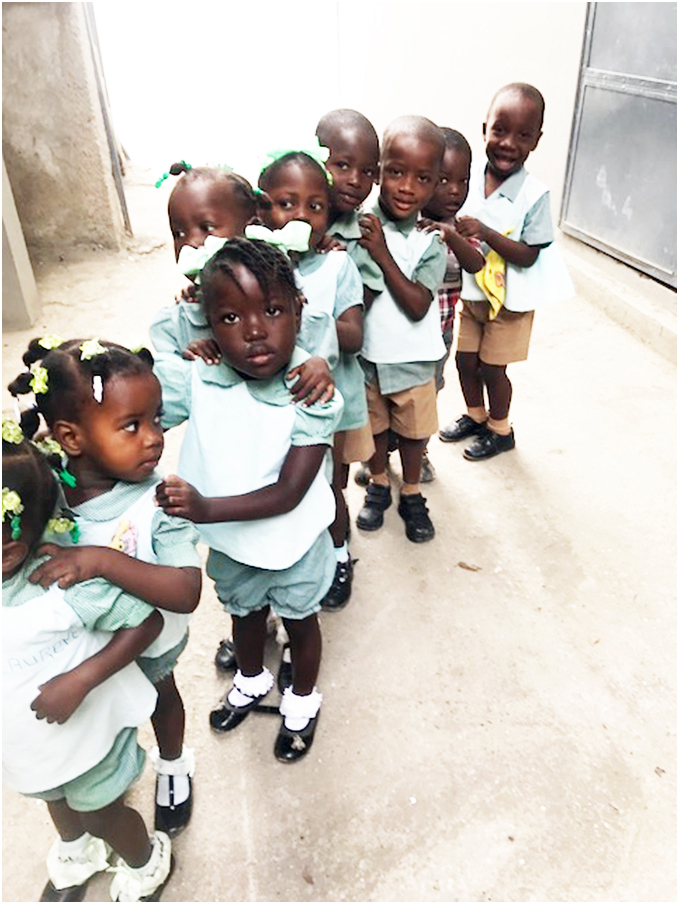 Children at Jesi-Mari Catholic School, where a school lunch program is proposed.