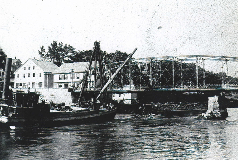 The area near the Damariscotta-Newcastle bridge as Thomas Gay remembered it. The new steel bridge had been built. The two buildings across from Gay's store, bought by John Sproul, show clearly to the left of the bridge. These are are two of the few old buildings still surviving in the area.