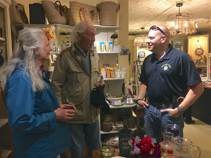 Wiscasset Police Chief Jeffrey Lange (right) talks with local residents Marie and John Reinhardt during his Chief Chat at September's Wiscasset Art Walk. According to Lange, community events give people an opportunity to have direct access to him, which he sees as a critical part of effective community policing.