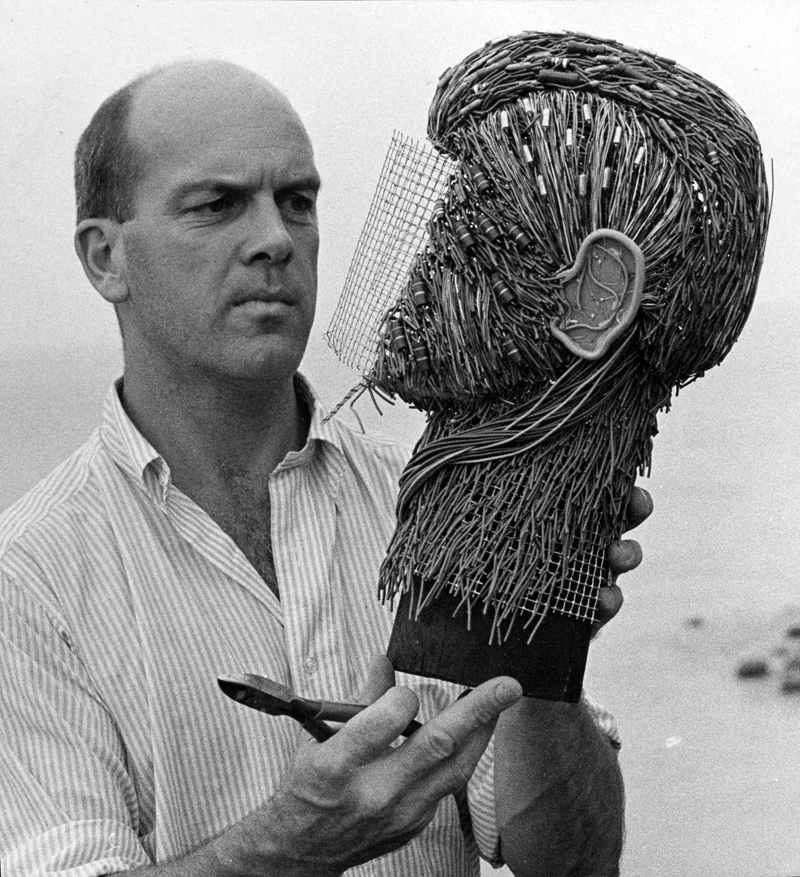 Ralph Moxcey works on a sculpture for Time magazine.