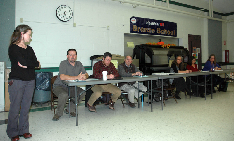 The AOS 93 Board opens its forum about Lincoln Academy at Great Salt Bay Community School in Damariscotta on Wednesday, Nov. 15. From left: Christa Thorpe, Joshua Hatch, Forrest Bryant, David Kolodin, Angela Russ, Stephanie Nelson, and Sara Mitchell. (Alexander Violo photo)