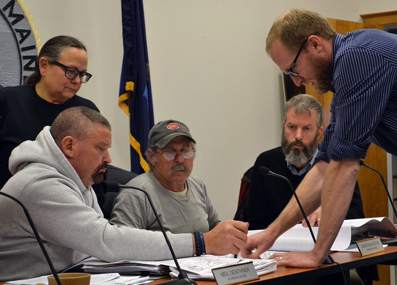From left: Damariscotta Planning Board members Shari Sage, Neil Genthner, Jonathan Eaton, and Adam Maltese look on as engineer Shawn Tobey explains part of the plan for the 435 Main St. development Monday, Nov. 13. (Maia Zewert photo)