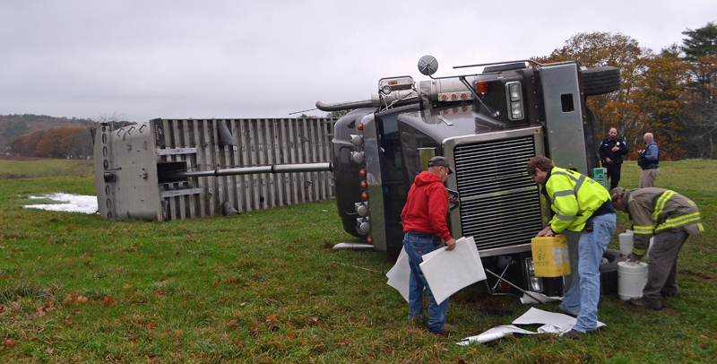 Damariscotta firefighters clean up oil spilled when a tractor-trailer tipped over at the Damariscotta River Association's Great Salt Bay Farm and Heritage Center the morning of Monday, Nov. 6. (Maia Zewert photo)