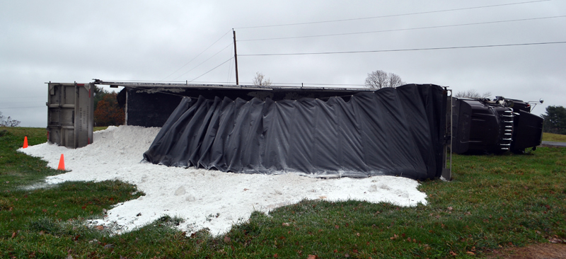 A tractor-trailer carrying agricultural lime tipped over at the Damariscotta River Association's Great Salt Bay Farm on Belvedere Road in Damariscotta the morning of Monday, Nov. 6. (Maia Zewert photo)