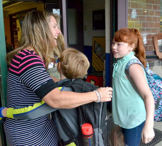 Great Salt Bay Community School Assistant Principal Kami Peaslee receives a congratulatory hug from students on the first day of school, Aug. 30. (Maia Zewert photo, LCN file)