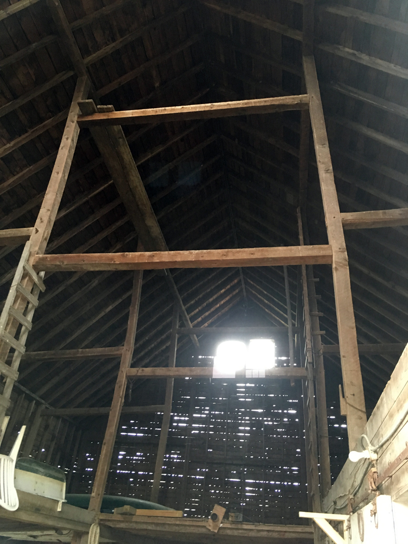 Breaks can be seen in four of the six upright supports of DRA's hay barn, which are visibly leaning to one side.