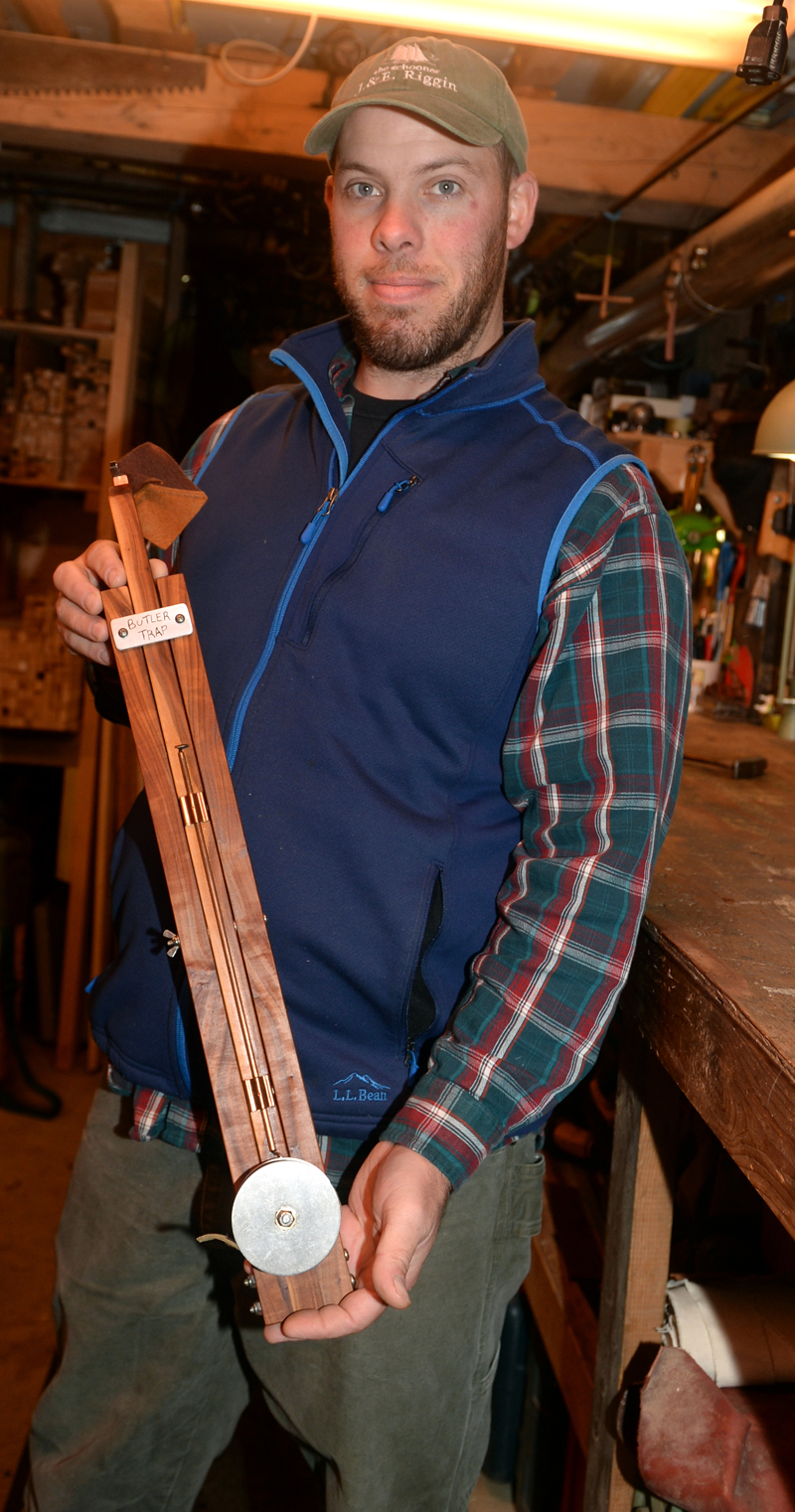 Oliver Butler holds an ice fishing trap made with apple wood. Butler makes traps from many kinds of wood at Butler Traps in Damariscotta Mills. (Paula Roberts photo)