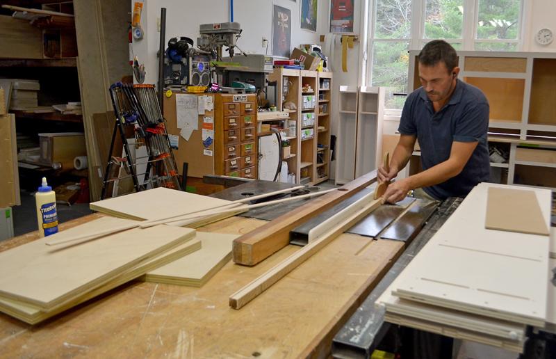 "Jonathan ""Jon"" Kelsey at work in the JK Custom Woodworking workshop in South Bristol. (Maia Zewert photo)"