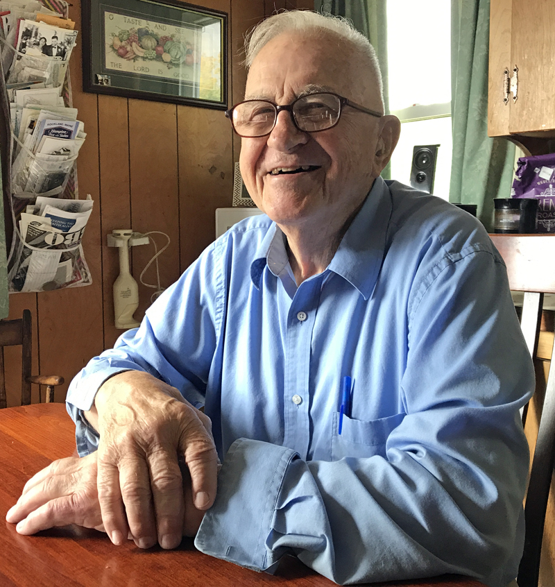 World War II veteran Albert R. Boynton reminisces about his experiences in the U.S. Navy at his kitchen table in North Whitefield. (J.W. Oliver photo)