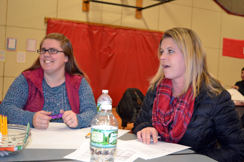 Whitefield Elementary School parents Nikki Ripley (left) and Shannon Peaslee talk about the dwindling numbers of PTA members during a discussion session at the Nov. 15 community forum. (Christine LaPado-Breglia photo)