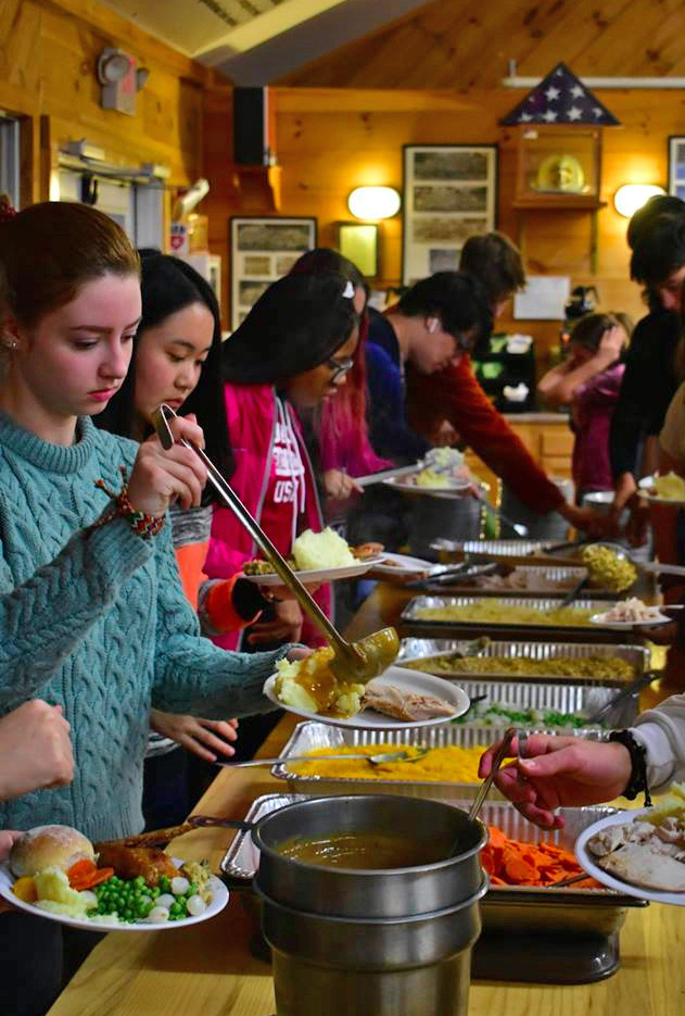 Lincoln Academy residential students enjoy a Thanksgiving feast at Camp Kieve on Wednesday, Nov. 22.