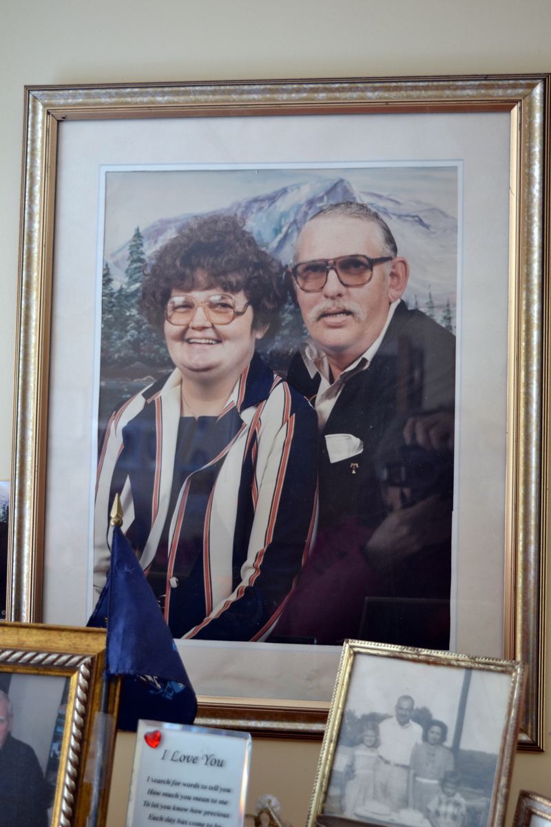 A 1987 photograph of Marilyn and Elden Beane sits alongside other memorabilia in their Crawford Commons room. (Christine LaPado-Breglia photo)