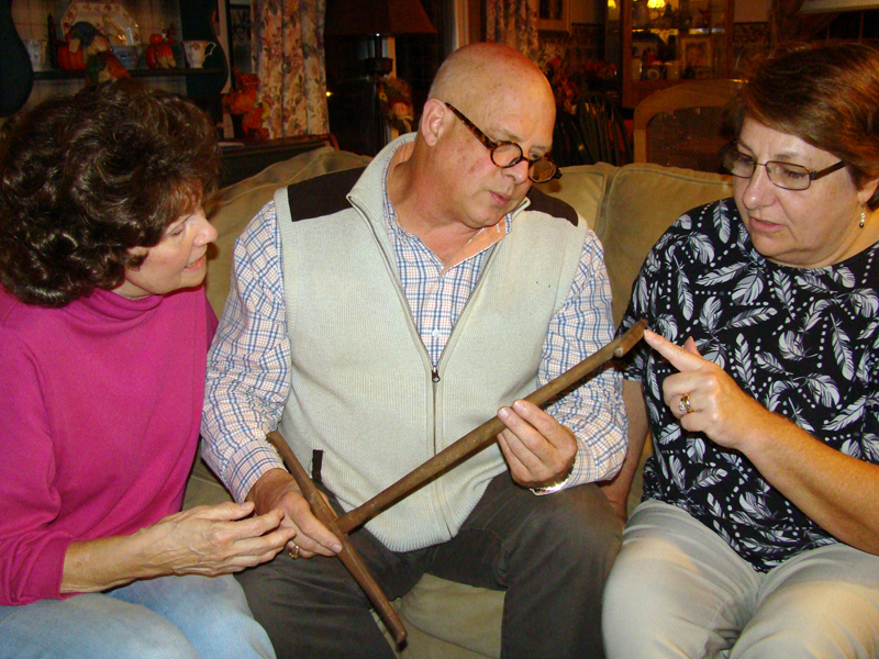 From left: Carolyn Baltes, John Bottero, and Cally Bartholomae discuss an unusual mystery antique that will be presented at a Nov. 11 event in Nobleboro.