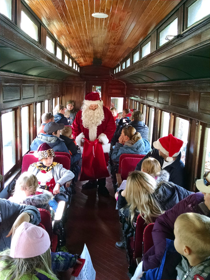 Santa Claus rides the North Pole Express.