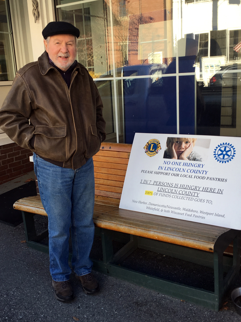 Rotarian Bob Topper solicits funds to help combat food insecurity.