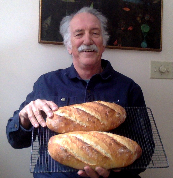 Bill Babb displays freshly baked loaves of bread.