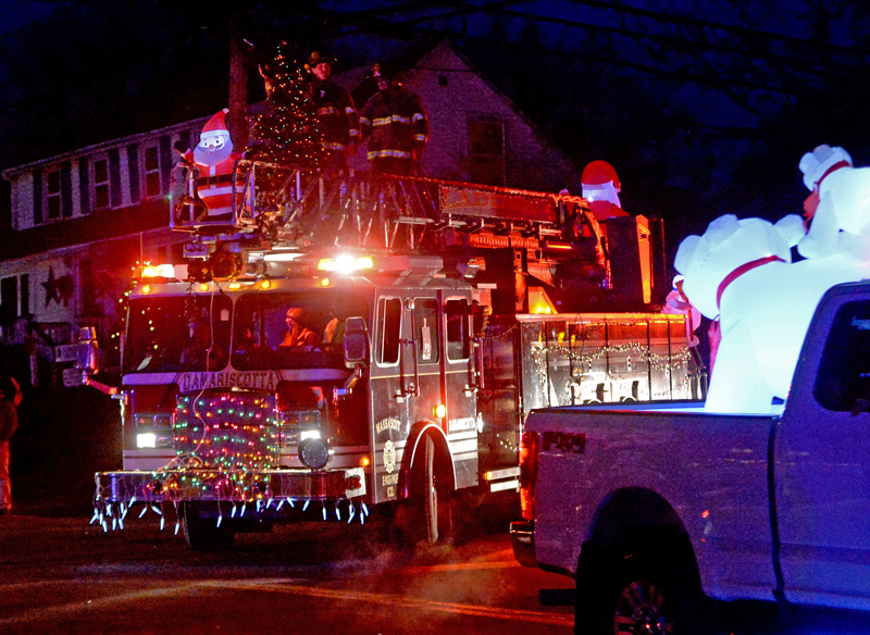 Polar bears watch the Damariscotta Fire Department ladder truck during the Villages of Light parade. (Paula Roberts photo)
