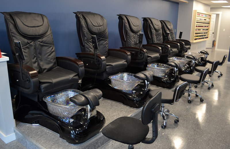New pedicure chairs line the wall at Mainely Nails in Damariscotta. The move into a larger space allowed the salon to add more chairs, according to owner Mary Huynh. (Maia Zewert photo)