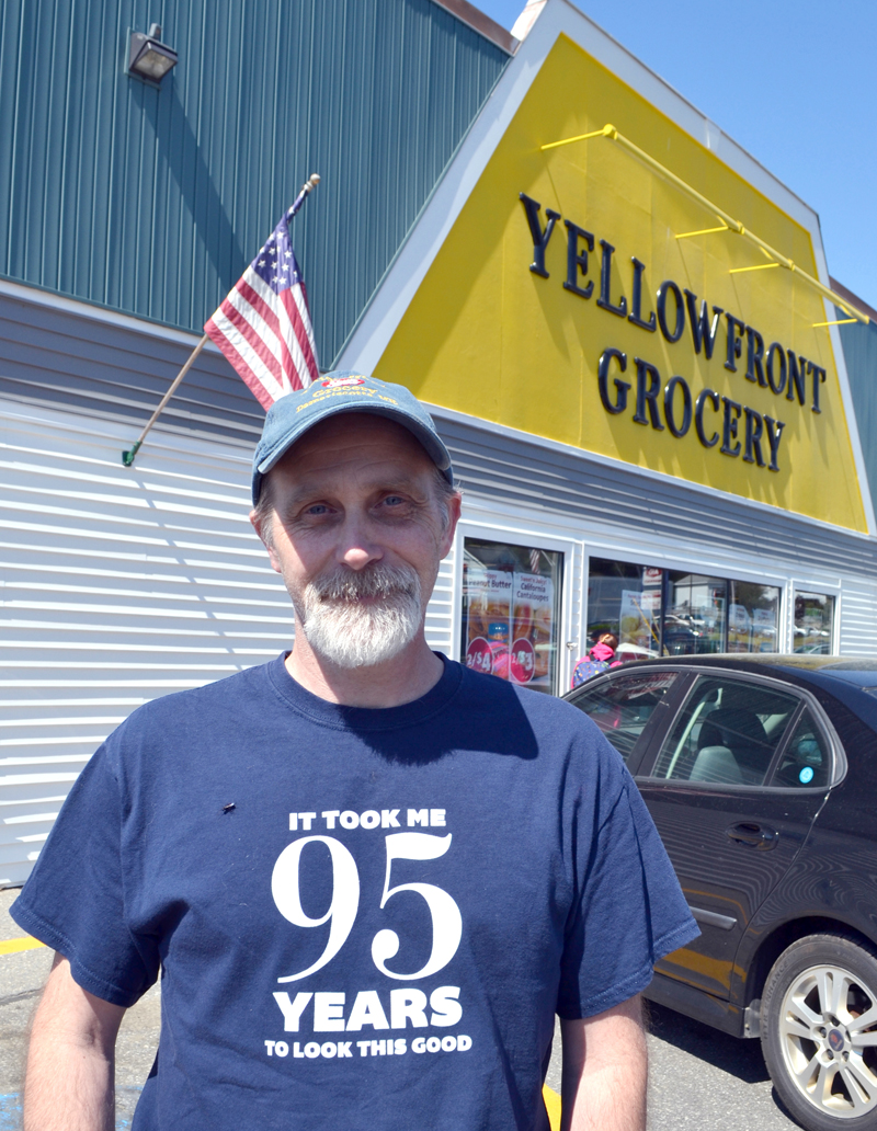 Yellowfront Grocery owner Jeff Pierce stands in front of the store at the time of its 95th anniversary celebration in June 2016. (Maia Zewert photo, LCN file)