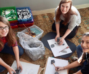 From left: Whitefield Elementary School seventh-graders Emmalee Donahue-Ripley, Hannah Jackson, and Jenna Perkins work with clay in Hollie Hilton's art class. (Photo courtesy Hollie Hilton)