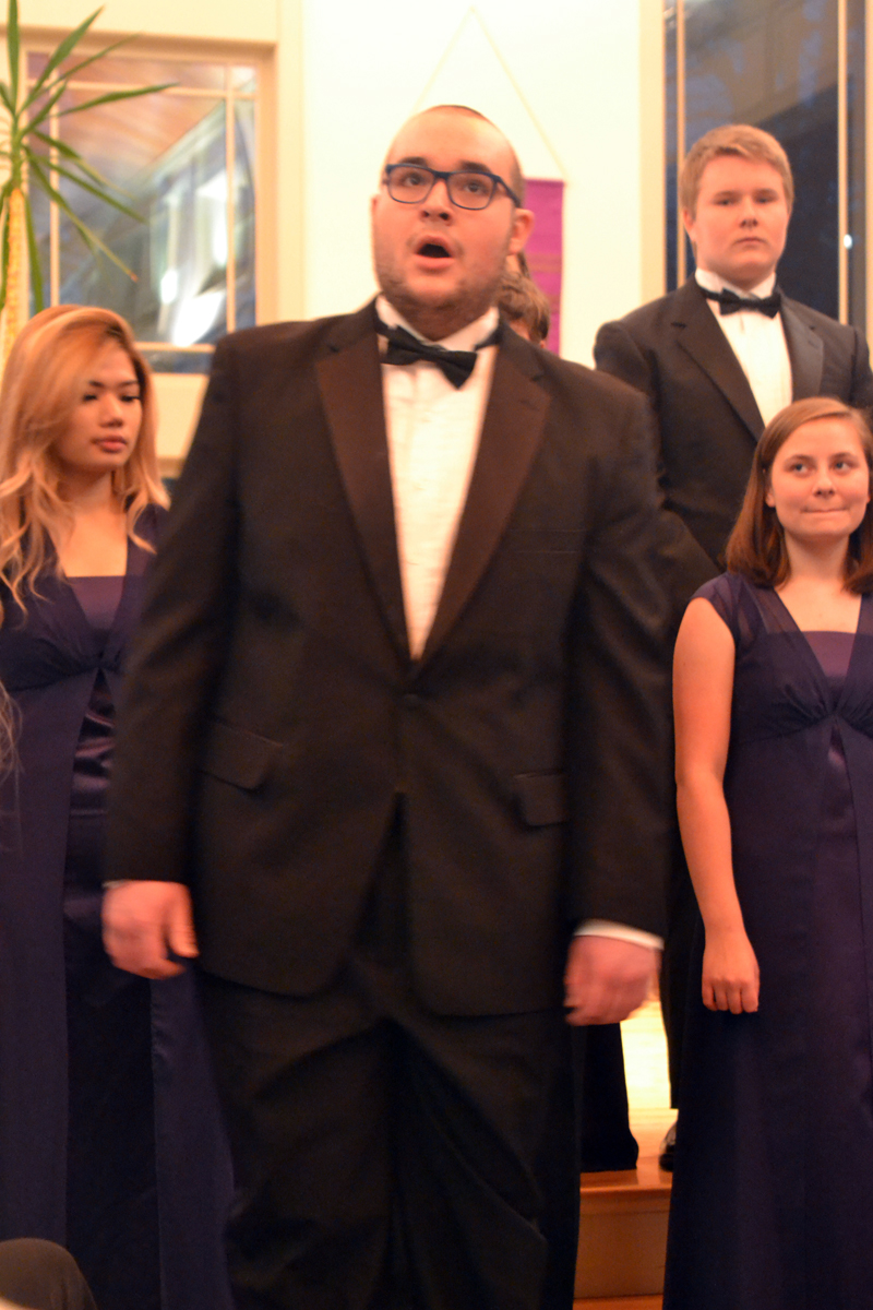 """Lincolnaire Miles Jackson (center) performs """"O Come All Ye Faithful"""" at the """"Sounds of the Season"""" concert Sunday, Dec. 10 as other Lincolnaires look on. (Christine LaPado-Breglia photo)"""
