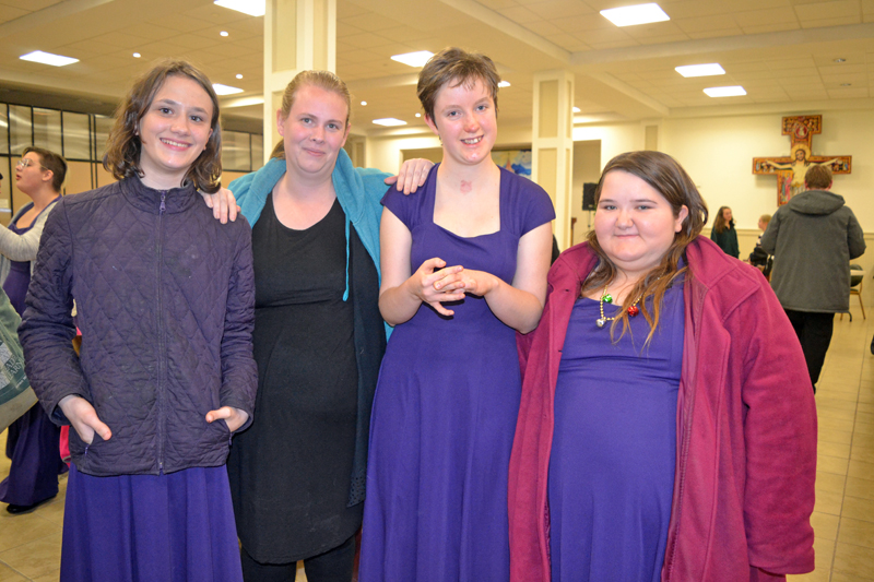 """From left: Lincoln Academy Concert Choir member Sierra Henderson, special education ed tech Morgan Brewer, and LA Concert Choir members Lydia LaPado and Tiffany Murray relax backstage after the Sunday, Dec. 10 """"Sounds of the Season"""" concert at St. Patrick's Catholic Church in Newcastle. (Christine LaPado-Breglia photo)"""