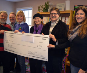 "River Company members present a check for $800 to Healthy Kids at the Healthy Kids office in Damariscotta on Wednesday, Dec. 20. From left: Nick Azzaretti, director of River Company's ""A Christmas Carol""; River Company Treasurer Mitchell Wellman; River Company Board of Directors members Judy McQuillen and Andrea Handel; Healthy Kids Executive Director Leslie Livingston; and Healthy Kids Board of Directors member Alicia Hunter. (Christine LaPado-Breglia photo)"