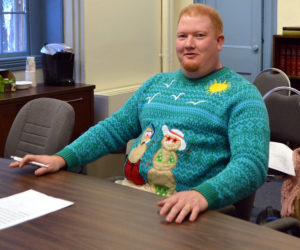 "Lincoln County Emergency Management Agency Director Casey Stevens wears a Christmas sweater to a meeting of the Lincoln County Board of Commissioners on Tuesday, Dec. 19. ""I have to wear this sweater at least one time during the Christmas season,"" he said. (Charlotte Boynton photo)"