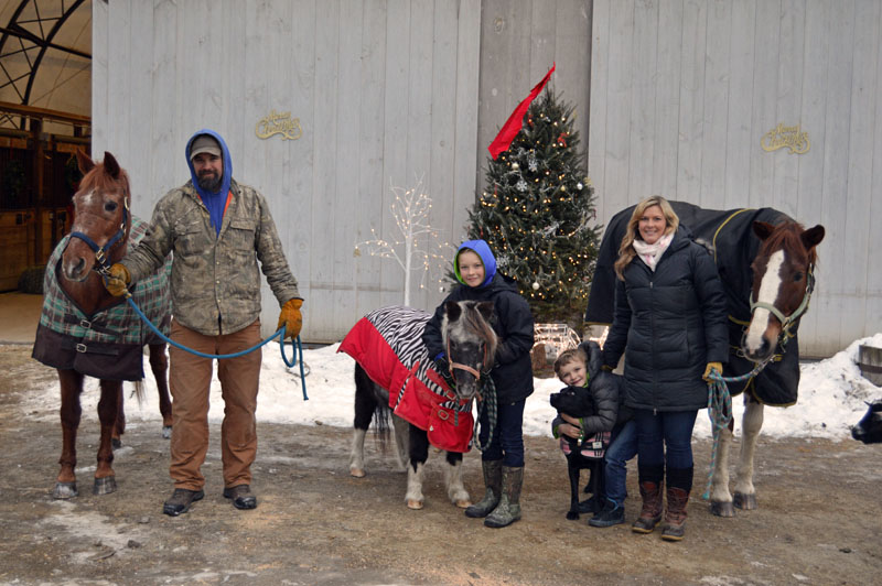 The Bradley family, from left: Pumpkin, Ross, Chief, Will, Sadie, Weston, Chrissy, and Logan. The family recently purchased Stonewall Stables in Nobleboro. (Matthew Mitterhoff photo)