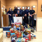 Atlantic Motorcar Conducting Toy Drive for Needy Kids