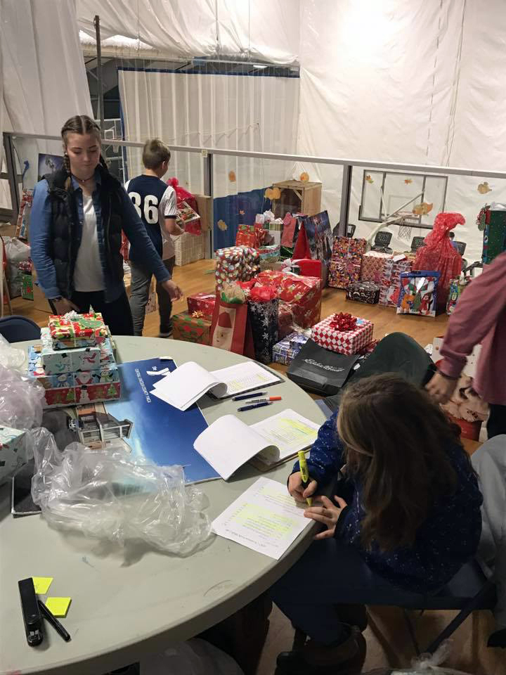 Youth help organize gifts.