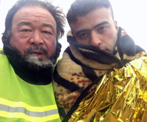 "Director Ai Weiwei (left) in ""Human Flow."" (Image courtesy Amazon Studios)"