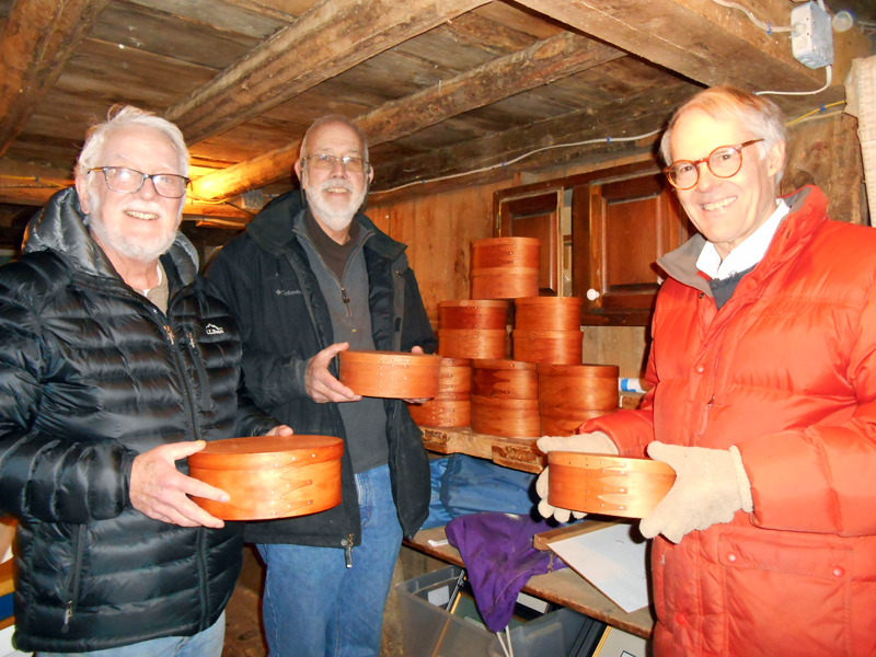 From left: Volunteers Mike Stevens, Bill Thomas, and Bob Ives show the first Shaker-inspired oval boxes.