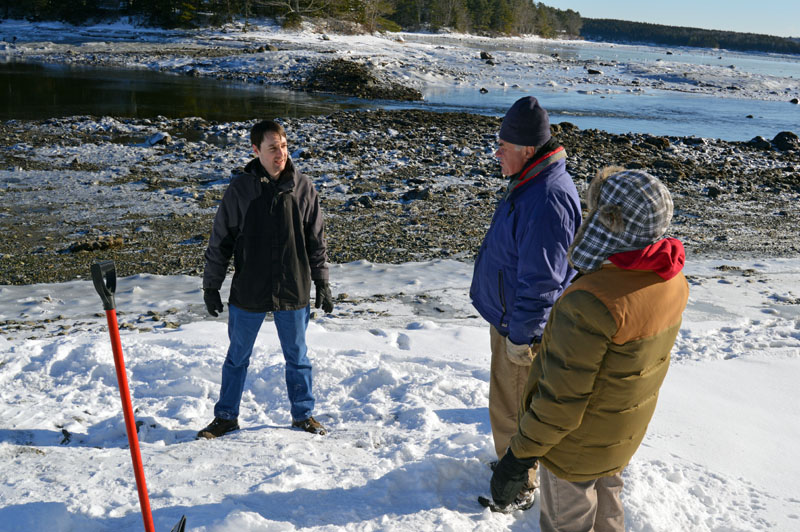 From left: Ian Riley, of American Concrete Industries Inc., talks with Bremen Selectmen Boe Marsh and Wendy Pieh during a meeting at the Storer Road boat ramp Wednesday, Dec. 27. (Matthew Mitterhoff photo)