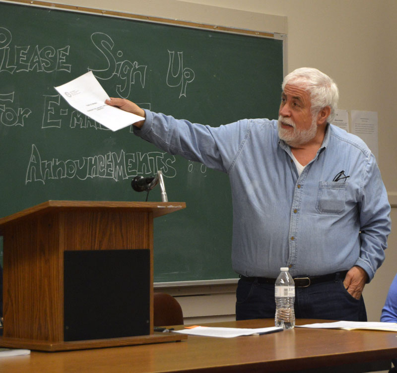 Bremen Selectman Hank Nevins reviews the town's change from a calendar year to a July-June fiscal year during town meeting Thursday, Jan. 11. (Alexander Violo photo)