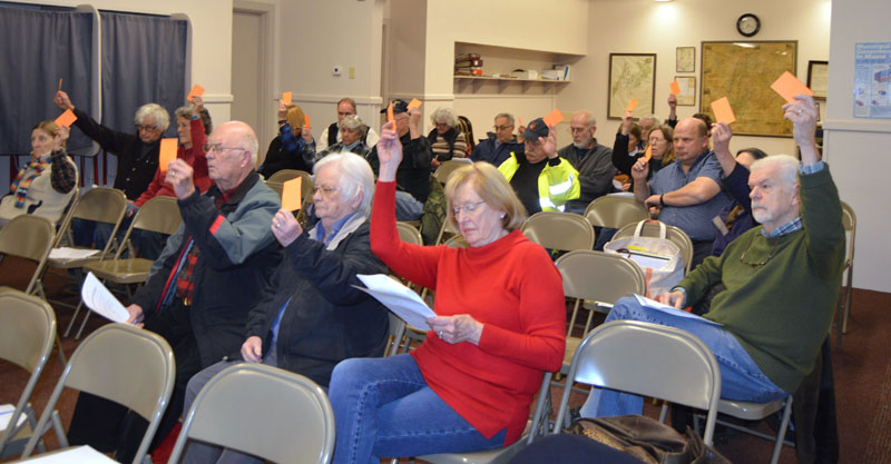 Bremen voters approve an article at town meeting Thursday, Jan. 11. (Alexander Violo photo)