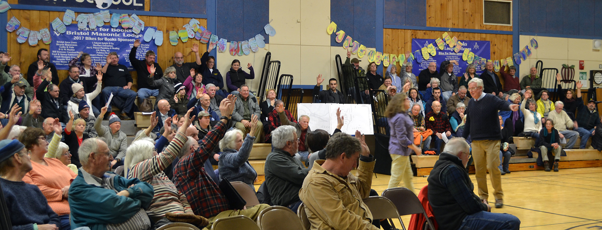 More than three-fourths of the audience votes in favor of repairs to the Bristol Mills Dam and improvements to the fish ladder in a straw poll at the close of a public hearing the evening of Tuesday, Jan. 30. (Maia Zewert photo)