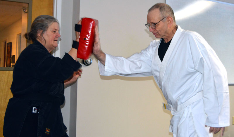 Danny Kelly performs a palm strike with instructor Linda Porter during a karate class at the Mobius community center in Damariscotta on Thursday, Dec. 21. (Matthew Mitterhoff photo)