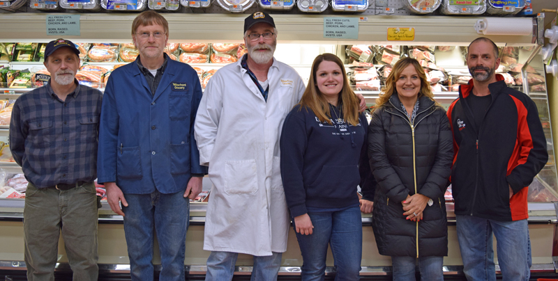The current and soon-to-be owners of Yellowfront Grocery pose for a photo in the store Monday, Jan. 22. From left: Jeff Pierce, Don Pierce, Steven Pierce, Alexandria Pierce, Jane Gravel, and Gary Gravel. (J.W. Oliver photo)