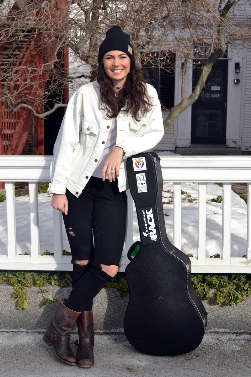 Lena Rich strikes a pose with her guitar in downtown Damariscotta. (Christine LaPado-Breglia photo)