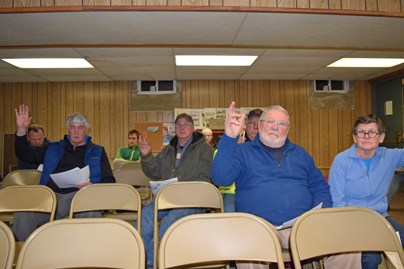 A small group of Edgecomb voters approve the appropriation of $35,678 from surplus to cover storm cleanup during a special town meeting at the town hall Tuesday, Jan. 16. (J.W. Oliver photo)