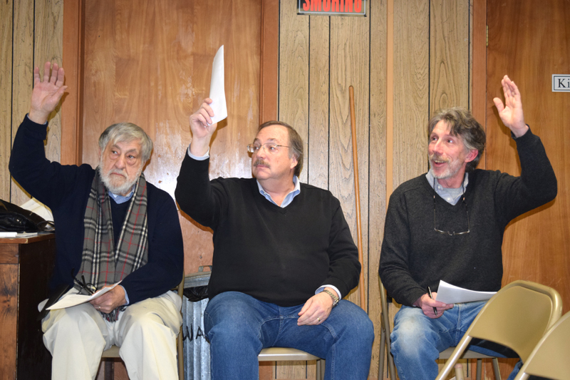 From left: Edgecomb Selectmen Jack Sarmanian, Ted Hugger, and Mike Smith vote to spend $200 from surplus for soil testing on a town property during a special town meeting at the town hall Tuesday, Jan. 16. (J.W. Oliver photo)
